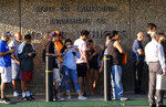 FILE - In this Aug. 7. 2018 file photo people line up at the California Department of Motor Vehicles prior to opening in the Van Nuys section of Los Angeles. A Republican lawyer who has waged lawsuits on behalf of the Trump administration is suing California and the state DMV, saying the agency is failing to verify whether non-citizens are being registered to vote. (AP Photo/Richard Vogel, File)