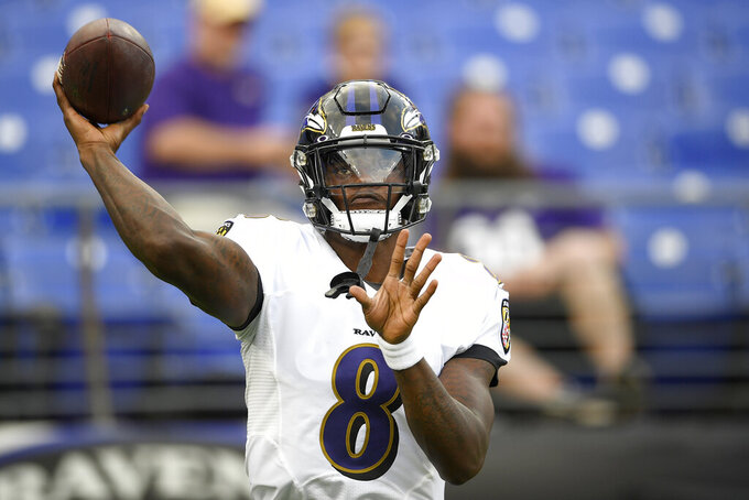 Baltimore Ravens quarterback Lamar Jackson works out prior to a NFL football preseason game against the Green Bay Packers, Thursday, Aug. 15, 2019, in Baltimore. (AP Photo/Nick Wass)