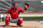 Washington Nationals catcher Kurt Suzuki catches a ball during spring training baseball practice Friday, Feb. 14, 2020, in West Palm Beach, Fla. (AP Photo/Jeff Roberson)