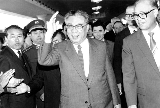 FILE - In this May 21, 1987, file photo, then North Korean President Kim Il Sung, center, and then Chinese Premier Zhao Ziyang make their way through a crowd of well-wishers at the train station in Beijing. North Korean leader Kim Jong Un's two-week absence from public view has inspired speculation and rumors, but past disappearances of North Korea's ruling elite frequently have simply shown the disconnect between insatiable curiosity about the country and the secrecy surrounding its leadership.(AP Photo/Neal Ulevich, File)