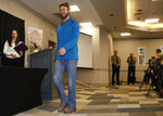 Travis Kauffman enters a news conference Thursday, Feb. 14, 2019, in Fort Collins, Colo., about his encounter with a mountain lion while running a trail just west of Fort Collins last week. (AP Photo/David Zalubowski)