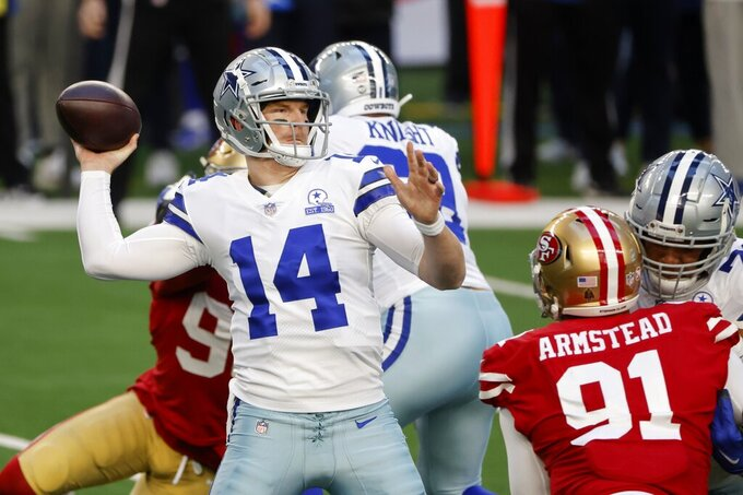 Dallas Cowboys quarterback Andy Dalton (14) throws a pass under pressure from San Francisco 49ers defensive end Arik Armstead (91) in the first half of an NFL football game in Arlington, Texas, Sunday, Dec. 20, 2020. (AP Photo/Michael Ainsworth)
