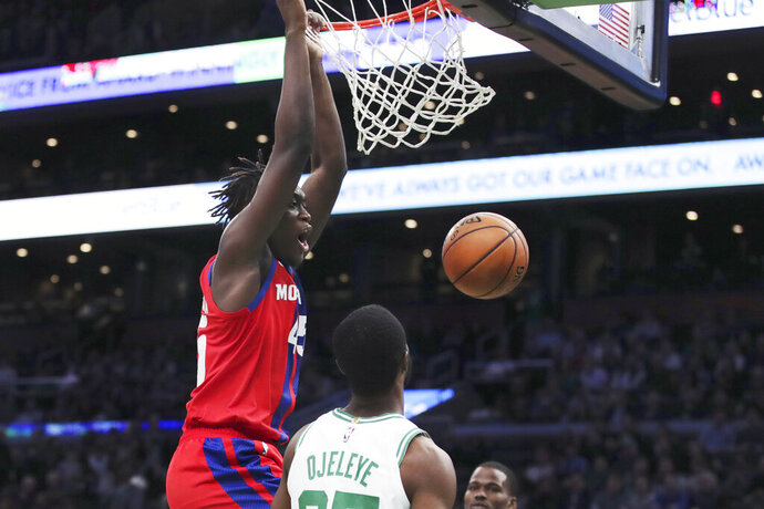 Detroit Pistons forward Sekou Doumbouya dunks over Boston Celtics forward Semi Ojeleye (37) during the second half of an NBA basketball game in Boston, Wednesday, Jan. 15, 2020. (AP Photo/Charles Krupa)