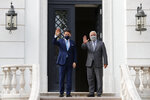 Italy's Prime Minister Giuseppe Conte, left and Portugal's Prime Minister Antonio Costa pose for a photo, before their meeting at the Sao Bento palace in Lisbon, Tuesday, July 7, 2020. Southern European countries are mounting a show of strength as negotiations over how much money they get from the EU, and in what form, comes to a crunch. (AP Photo/Armando Franca)