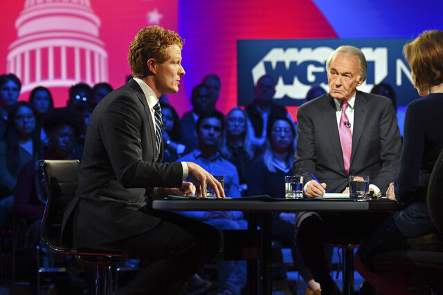 Representative Joe Kennedy III (D-MA), left, and Senator Ed Markey (D-MA), center left, square off in the first Senate primary debate hosted by WGBH News and moderated by Margery Egan and Jim Braude on Tuesday, February 18, 2020 at the WGBH Studios in Boston, Massachusetts. (Meredith Nierman/WGBH via AP, Pool)