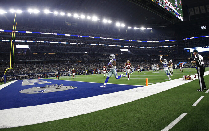 Dallas Cowboys wide receiver Michael Gallup (13) scores a touchdown against the Washington Redskins on a 32-yard pass during the second half of an NFL football game in Arlington, Texas, Sunday, Dec. 15, 2019. (AP Photo/Ron Jenkins)