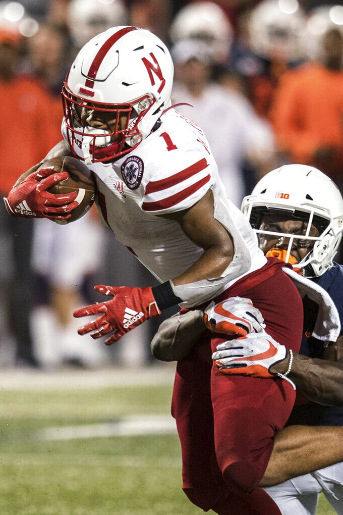 Nebraska's Wan'Dale Robinson (1) shakes off Illinois defender Tony Adams (6) during the second half of a NCAA college football game Saturday, Sept. 21, 2019, in Champaign, Ill. (AP Photo/Holly Hart)
