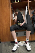 Purdue's Ryan Cline wipes his face in the locker room following the men's NCAA Tournament college basketball South Regional final game against Virginia, Saturday, March 30, 2019, in Louisville, Ky. Virginia won 80-75. (AP Photo/Timothy D. Easley)