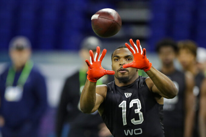 Texas wide receiver Devin Duvernay runs a drill at the NFL football scouting combine in Indianapolis, Thursday, Feb. 27, 2020. (AP Photo/Michael Conroy)