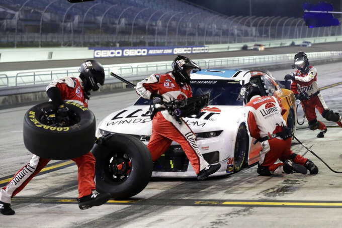 Alex Bowman makes a pit stop during a NASCAR Cup Series auto race Sunday, June 14, 2020, in Homestead, Fla. (AP Photo/Wilfredo Lee)