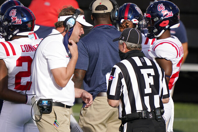 Mississippi head coach Lane Kiffin talks with an official in the first half of an NCAA college football game against Vanderbilt Saturday, Oct. 31, 2020, in Nashville, Tenn. (AP Photo/Mark Humphrey)