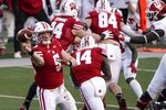 Wisconsin's Graham Mertz throws a pass during the first half of an NCAA college football game against Indiana Saturday, Dec. 5, 2020, in Madison, Wis. (AP Photo/Morry Gash)