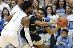 North Carolina's Leaky Black (1) defends Wake Forest's Brandon Childress (0) during the first half of an NCAA college basketball game in Chapel Hill, N.C., Tuesday, March 3, 2020. (AP Photo/Chris Seward)