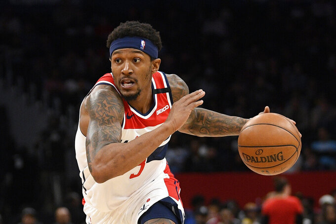 FILE - In this March 8, 2020, file photo, Washington Wizards guard Bradley Beal drives during an NBA basketball game against the Miami Heat in Washington. Wizards leading scorer Bradley Beal won't take part in the restart of the NBA season because of a right rotator cuff injury. (AP Photo/Nick Wass, File)