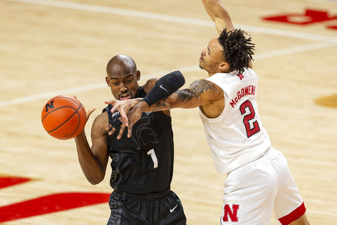 Michigan State guard Joshua Langford (1) fights off Nebraska guard Trey McGowens (2) reaching for the ball in the first half during an NCAA college basketball game on Saturday, Jan. 2, 2021, in Lincoln, Neb. (AP Photo/John Peterson)