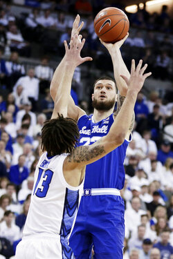 Seton Hall's Sandro Mamukelashvili (23) shoots over Creighton's Christian Bishop (13) during the first half of an NCAA college basketball game in Omaha, Neb., Saturday, March 7, 2020. (AP Photo/Nati Harnik)