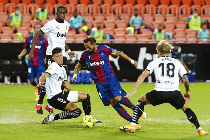 Levante's Jose Luis Morales scores the opening goal during the Spanish La Liga soccer match between Valencia and Levante at the Mestalla Stadium in Valencia, Spain, Sunday, Sept. 13, 2020. (AP Photo/Alberto Saiz)