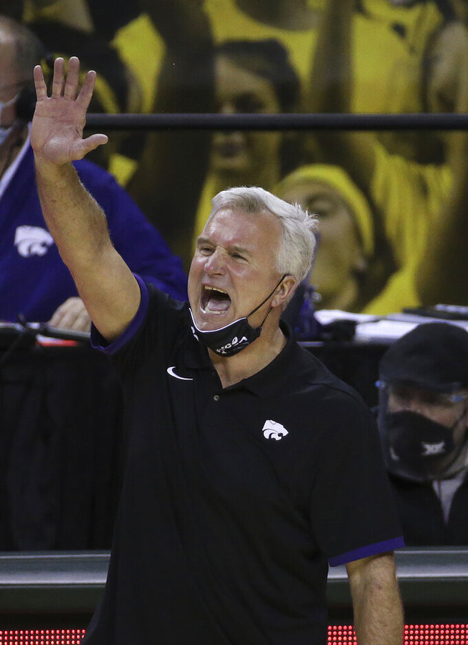 Kansas State head coach Bruce Weber calls in a play to his team in the first half of an NCAA college basketball game against Baylor, Wednesday, Jan. 27, 2021, in Waco, Texas. (AP Photo/Jerry Larson)