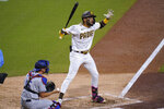 San Diego Padres' Fernando Tatis Jr reacts to a called strike while batting during the sixth inning of the team's baseball game against the Los Angeles Dodgers on Saturday, April 17, 2021, in San Diego. (AP Photo/Gregory Bull)