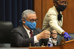 Rep. Bobby Scott, D-Va., puts a cloth cover over his microphone during a House Committee on Education and Labor Subcommittee on Workforce Protections hearing examining the federal government's actions to protect workers from COVID-19, Thursday, May 28, 2020 on Capitol Hill in Washington. (Chip Somodevilla/Pool via AP)