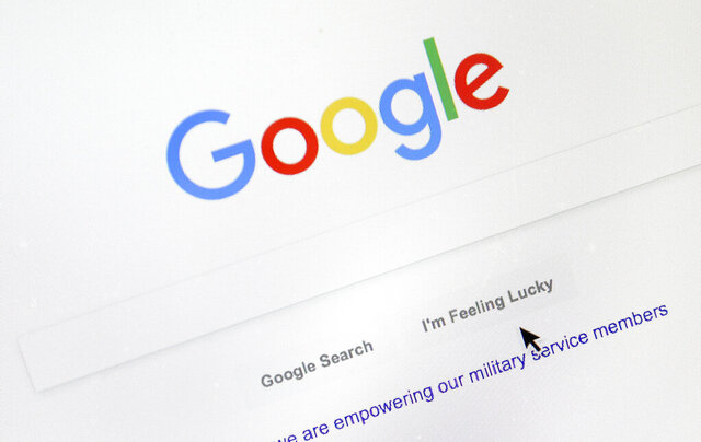 FILE - In this Aug. 28, 2018, file photo, a cursor moves over Google's search engine page, in Portland, Ore. A French appeals court on Thursday, Oct. 8, 2020 upheld an order for Google to pay media companies to show their news content in search results. The Paris Court of Appeal rejected a challenge by the U.S. tech company, which had refused to comply with an order by France's competition authority to negotiate with publishers and press agencies for payments to display their material. (AP Photo/Don Ryan, File)
