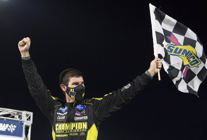 Grant Enfinger celebrates after winning the NASCAR Truck Series auto race at Martinsville Speedway in Martinsville, Va., Friday, Oct. 30, 2020. (AP Photo/Lee Luther Jr.)
