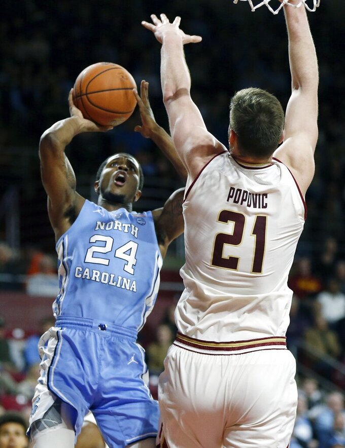North Carolina's Kenny Williams (24) shoots against Boston College's Nik Popovic (21) during the second half of an NCAA college basketball game in Boston, Tuesday, March 5, 2019. (AP Photo/Michael Dwyer)