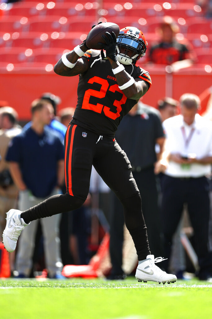 Cleveland Browns strong safety Damarious Randall (23) catches a pass during warm-ups prior to an NFL game against the Tennessee Titans, Sunday, Sept. 8, 2019, in Cleveland. (Margaret Bowles via AP)
