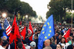 Protesters take part in an anti-government rally, demanding the resignation of the Socialist Prime Minister Edi Rama, in Tirana, Saturday, May 25, 2019. The European Union, the United States and the Organization for Security and Cooperation in Europe have called on Albania's opposition to avoid violence in its protests and to hold talks resolve the country's political deadlock. (AP Photo/Hektor Pustina)