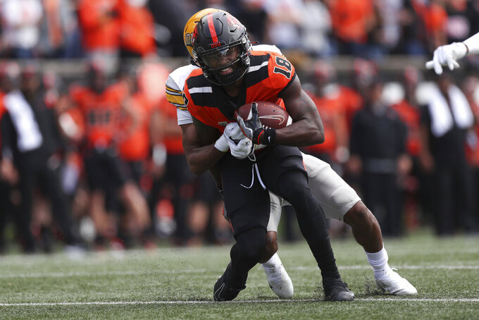 Oregon State wide receiver Zeriah Beason (18) is brought down by Idaho cornerback Marcus Harris (11) during the first half of an NCAA college football game, Saturday, Sept. 18, 2021, in Corvallis, Ore. (AP Photo/Amanda Loman)