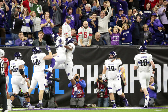 Northwestern wide receiver Trey Pugh (80) and wide receiver Cameron Green (84) celebrate a touchdown reception by Green during the second half of the Big Ten championship NCAA college football game against Ohio State, Saturday, Dec. 1, 2018, in Indianapolis. (AP Photo/AJ Mast)