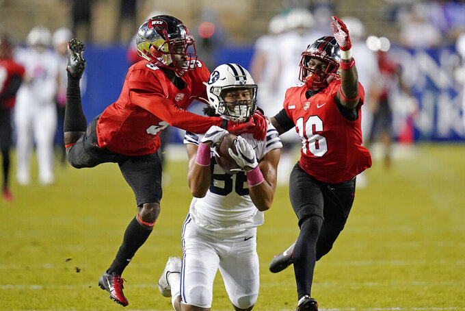 Western Kentucky's Dominique Bradshaw, left, and Kendrick Simpkins (16) defend on an incomplete pass to BYU wide receiver Keanu Hill during the first half of an NCAA college football game Saturday, Oct. 31, 2020, in Provo, Utah. (AP Photo/Rick Bowmer, Pool)