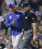 Texas Rangers manager Chris Woodward (8) argues with home plate umpire Angel Hernandez during the sixth inning of a baseball game against the Boston Red Sox at Fenway Park in Boston, Tuesday, June 11, 2019. Woodward was ejected later in the exchange. (AP Photo/Charles Krupa)