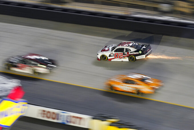 Sparks fly from the car of Brett Moffitt (02) after he hit the wall during a NASCAR Xfinity Series auto race at Bristol Motor Speedway Friday, Sept. 17, 2021, in Bristol, Tenn. (AP Photo/Mark Humphrey)