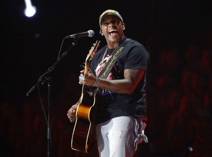 "FILE - Jimmie Allen performs ""Best Shot"" at the CMT Music Awards in Nashville, Tenn. on June 5, 2019. Allen will be introduced today as singer of the national anthem prior to the May 30 Indianapolis 500 at Indianapolis Motor Speedway.  (AP Photo/Mark Humphrey, File)"