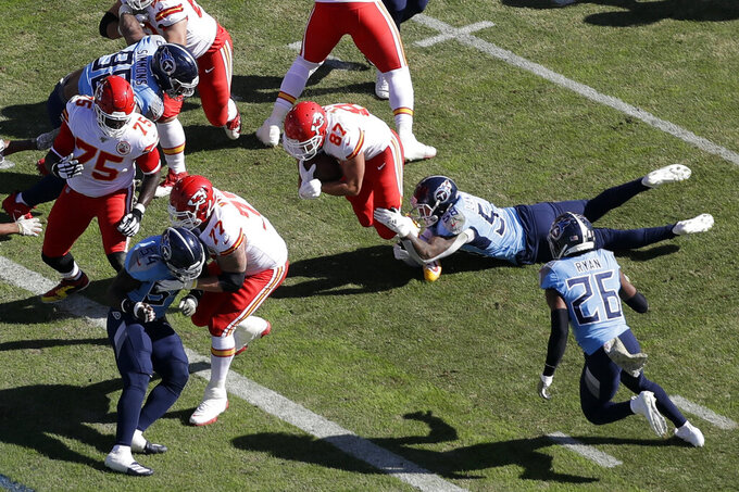 Kansas City Chiefs tight end Travis Kelce (87) gets past Tennessee Titans linebacker Harold Landry (58) as Kelce scores a touchdown in the first half of an NFL football game Sunday, Nov. 10, 2019, in Nashville, Tenn. (AP Photo/James Kenney)