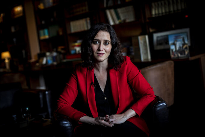 The incumbent conservative Madrid president Isabel Diaz Ayuso speaks during an interview with The Associated Press in Madrid, Spain, April 26, 2021. (AP Photo/Bernat Armangue)