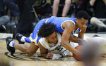 UCLA guard Jaylen Hands, top, fights for control of the ball with Colorado guard D'Shawn Schwartz in the second half of an NCAA college basketball game Thursday, March 7, 2019, in Boulder, Colo. (AP Photo/David Zalubowski)