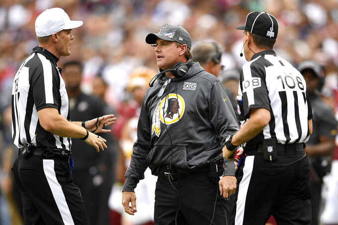 Washington Redskins head coach Jay Gruden speaks to officals during the first half of an NFL football game between the Washington Redskins and the New England Patriots, Sunday, Oct. 6, 2019, in Landover, Md. (AP Photo/Nick Wass)