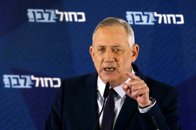FILE - In this Saturday, March 7, 2020 file photo, Blue and White party leader Benny Gantz delivers a statement in Tel Aviv, Israel. Israel's President Reuven Rivlin on Sunday, March 15 said he has decided to give Gantz the first opportunity to form a new government following an inconclusive national election this month. Rivlin's office announced his decision late Sunday after consulting with leaders of all of the parties elected to parliament. (AP Photo/Sebastian Scheiner, File)