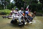 Migrants cross the Acandi River on a horse cart in Acandi, Colombia, Tuesday, Sept. 14, 2021. (AP Photo/Fernando Vergara)