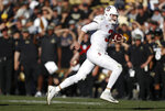Stanford quarterback K.J. Costello runs for a short gain against Colorado in the second half of an NCAA college football game, Saturday, Nov. 9, 2019, in Boulder, Colo. Colorado won 16-13. (AP Photo/David Zalubowski)