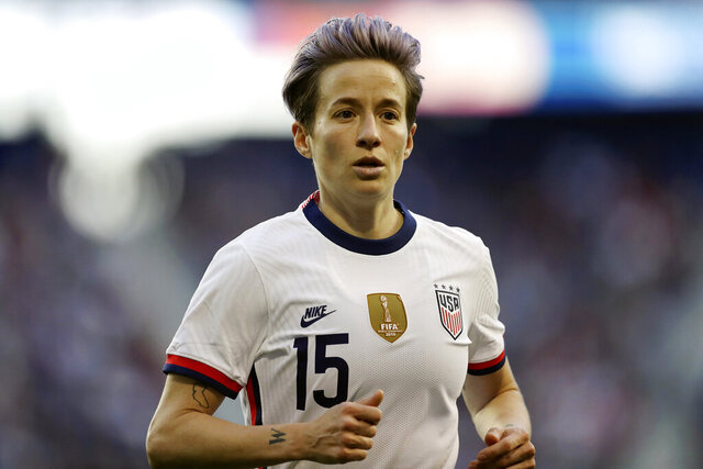 FILE - In this March 8, 2020, file photo, U.S. forward Megan Rapinoe runs during the second half of a SheBelieves Cup soccer match against Spain in Harrison, N.J. Rapinoe is among the athletes touting the benefits of CBD for pain management and recovery. CBD products have become big business after the 2018 Farm Bill made hemp a legal agricultural crop. CBD is found in both hemp and marijuana plants. It has been hailed as a health and wellness aid and infused in everything from gummies to lotions. Rapinoe's twin sister Rachael has helped launch a CBD products company called Mendi, which is geared toward athletes. (AP Photo/Steve Luciano, File)