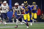 New England Patriots' Julian Edelman (11) runs the ball ahead of Los Angeles Rams' Cory Littleton (58) during the second half of the NFL Super Bowl 53 football game Sunday, Feb. 3, 2019, in Atlanta. (AP Photo/Jeff Roberson)