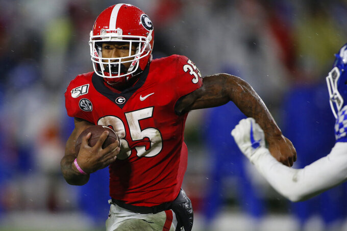 Georgia running back Brian Herrien (35) breaks away to score a touchdown in the second half of a NCAA football game between Georgia and Kentucky in Athens, Ga., on Saturday, Oct. 19, 2019. (Joshua L. Jones/Athens Banner-Herald via AP)