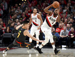 Portland Trail Blazers forward Maurice Harkless, right, steals the ball from Atlanta Hawks guard Jeremy Lin, left, during the second half of an NBA basketball game in Portland, Ore., Saturday, Jan. 26, 2019. The Blazers won 120-111. (AP Photo/Steve Dykes)