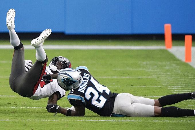 Carolina Panthers cornerback Rasul Douglas (24) hits Tampa Bay Buccaneers strong safety Justin Evans (21) during the second half of an NFL football game, Sunday, Nov. 15, 2020, in Charlotte , N.C. (AP Photo/Gerry Broome)