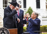 Gov. Greg Abbott presented the Governor's Medal of Courage on Monday morning Jan. 13, 2020 to Jack Wilson, who shot and killed 43-year-old gunman Keith Thomas who opened fire on the congregation and killed two people at West Freeway Church of Christ in White Settlement, Texas on December 29th, 2019. The Governor's Medal of Courage is given to civilians who display great acts of heroism by risking their own safety to save another's life. It is the highest award given to civilians by the Governor. (Ricardo B. Brazziell/Austin American-Statesman via AP)