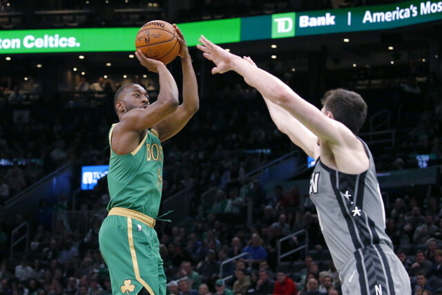 Boston Celtics guard Kemba Walker (8) shoots over Brooklyn Nets forward Rodions Kurucs during the second half of an NBA basketball game Tuesday, March 3, 2020, in Boston. (AP Photo/Mary Schwalm)