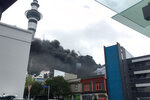 Smoke billows across the central business district skyline Tuesday, Oct. 22, 2019, in Aukland, New Zealand. A large fire that broke out on the roof of a convention center that's under construction in downtown Auckland sent plumes of thick black smoke over New Zealand's largest city. (Duncan Bridgeman/New Zealand Herald via AP)